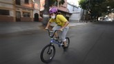 Venezuelan Olympic medalist Stefany Hernandez, a BMX racing cyclist, wears a face mask while training in Caracas, Venezuela, Saturday, April 25, 2020. Despite a quarantine to curb the spread of COVID-19, Hernandez trains three times a week in hopes of qualifying for the 2021 Tokyo Summer Olympics. (AP Photo/Matias Delacroix)