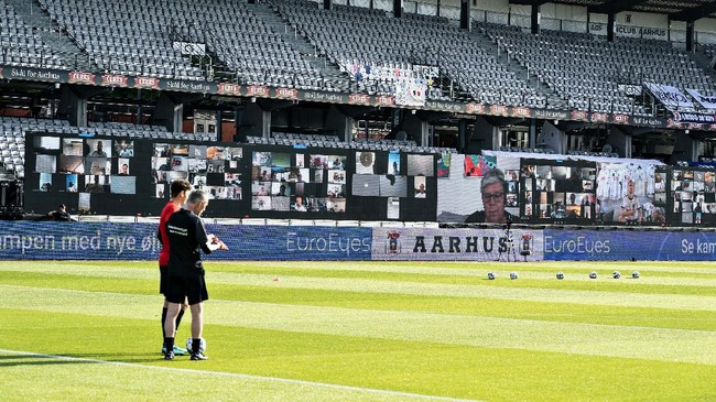 Big screens in place prior to the Danish Super League soccer match between AGF and Randers FC at Ceres Park in Aarhus, Denmark, Thursday 28 May 2020. The match is the first to be played after the shutdown due to the outbreak of the coronavirus and is being played without spectators and with restrictions. (Henning Bagger/Ritzau Scanpix via AP)