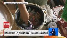 VIDEO: Cegah Covid-19, Pedagang Simpan Uang di Penanak Nasi
