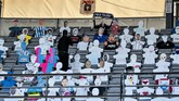 Cardboard figures are displayed in the seats during the Danish Super League soccer match between AGF and Randers FC via videolink, at Ceres Park in Aarhus, Denmark, Thursday, May 28, 2020. The match is the first to be played after the shutdown due to the outbreak of the coronavirus and is being played without spectators and with restrictions. (Henning Bagger/Ritzau Scanpix via AP)