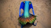 A mermaid tail, which belongs to a member of the Israeli Mermaids Community, is placed on a chair at the beachfront in Bat Yam, near Tel Aviv, Israel, Saturday, May 23, 2020. Members of the Israeli mermaid community gathered at the beachfront to mark the beginning of the bathing season. (AP Photo/Oded Balilty)