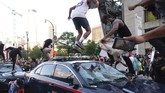 Protesters smash police cars in Atlanta, Friday, May 29, 2020. Protesters marched for George Floyd, who died after being restrained by Minneapolis police officers on Memorial Day. (Ben Gray/Atlanta Journal-Constitution via AP)