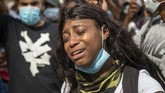 Colleen Harrison of Clayton County cries for action on the steps of the Georgia State Capitol building during a protest in Atlanta, Friday, May 29, 2020. Protesters gathered for George Floyd, who died after being restrained by Minneapolis police officers on Memorial Day. (Alyssa Pointer/Atlanta Journal-Constitution via AP)