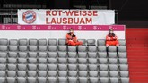 Medical personell sit in an empty tribune ahead of the German first division Bundesliga football match FC Bayern Munich v Fortuna Duesseldorf on May 30, 2020 in Munich, southern Germany. (Photo by Christof STACHE / various sources / AFP) / DFL REGULATIONS PROHIBIT ANY USE OF PHOTOGRAPHS AS IMAGE SEQUENCES AND/OR QUASI-VIDEO