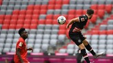 Bayern Munich's Canadian midfielder Alphonso Davies (L) and Fortuna Duesseldorf's Austrian midfielder Kevin Stoeger Duesseldorf vie for the ball during the German first division Bundesliga football match FC Bayern Munich v Fortuna Duesseldorf on May 30, 2020 in Munich, southern Germany. (Photo by Christof STACHE / various sources / AFP) / DFL REGULATIONS PROHIBIT ANY USE OF PHOTOGRAPHS AS IMAGE SEQUENCES AND/OR QUASI-VIDEO