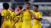 Dortmund's Moroccan defender Achraf Hakimi shows a