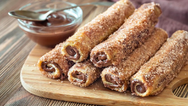 French toast roll-ups on the wooden board
