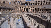 Restorers work inside the Colosseum in Rome, Monday, June 1, 2020, during a press conference announcing the reopening to the public of one of Italy's most visited monument, after more of two months of lockdown for the coronavirus pandemics. The Colosseum, Palatine, Roman Forum and Domus Aurea reopens to the public on 1 June with some access restrictions for visitors. (AP Photo/Domenico Stinellis)