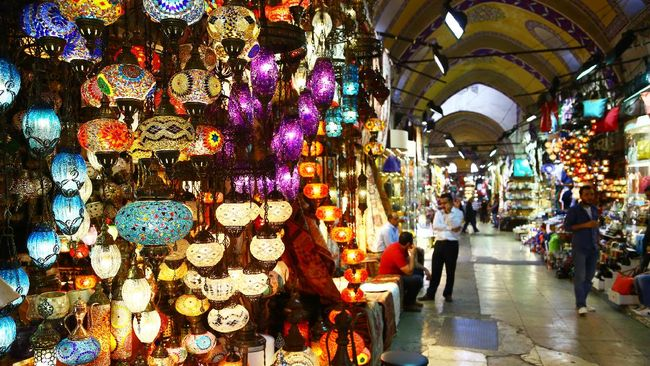 Istanbul, Turkey - October 21, 2014: a store in Grand bazaar, selling typical multicolored turkish lights. Some people are visible in the image.