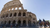 Mounted policemen, right, and Carabinieri in high uniform, left, patrol outside the Colosseum in Rome, Monday, June 1, 2020, during the reopening to the public of one of Italy's most visited monument, after more of two months of lockdown for the coronavirus pandemics. The Colosseum, Palatine, Roman Forum and Domus Aurea reopens to the public on 1 June with some access restrictions for visitors. (AP Photo/Domenico Stinellis)