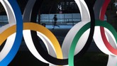 A man jogs past the Olympic rings in Tokyo. Former Olympic minister Toshiaki Endo said at a meeting of the ruling Liberal Democratic Party on Friday, June 5, 2020, that a decision of whether to hold the Games should be made around March, which is a crucial time to finalize participating athletes, NHK said. (AP Photo/Jae C. Hong)