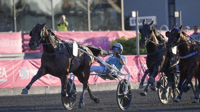 The horse Propulsion comes in to win with driver Orjan Kihlstrom, during the final of Elitloppet trotting event at Solvalla track, being run without an audience due to the COVID-19 coronavirus lockdown, Sunday May 31, 2020. (Henrik Montgomery / TT via AP)