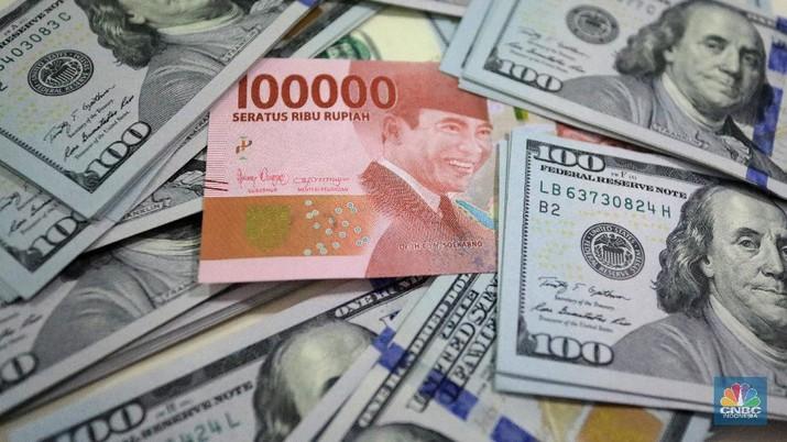Ilustrasi Rupiah dan dolar (CNBC Indonesia/Andrean Kristianto) - PT Rifan Financindo