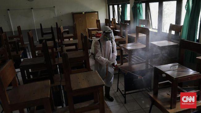 Agenda pengambilan rapor siswa di MAN 22 Jakarta Barat tertunda hingga Januari 2021 akibat klaster Covid-19 pasca-study tour.