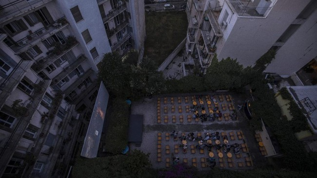 In this Wednesday, June 3, 2020 photo the Panathinea outdoor cinema in Neapoli, central Athens, is seen in an aerial view as moviegoers watch the 2019 South Korean black comedy film Parasite. (AP Photo/Petros Giannakouris)