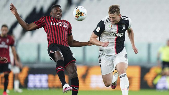 AC Milan's Rafael Leao, left, and Juventus' Matthijs De Ligt vie for the ball during an Italian Cup second leg soccer match between Juventus and AC Milan at the Allianz stadium, in Turin, Italy, Friday, June 12, 2020. The match was being played without spectators because of the coronavirus lockdown. (Spada/LaPresse via AP)
