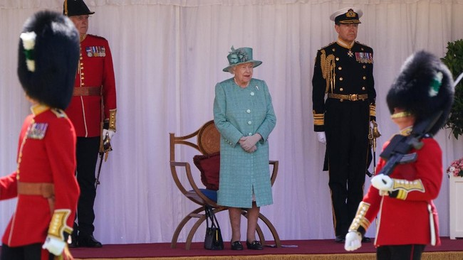 Britain's Queen Elizabeth II looks out during a military parade to mark her official birthday at Windsor Castle in Windsor, England, Saturday June 13, 2020. Queen Elizabeth II's birthday is being marked with a special ceremony taking care for social distancing by everyone present amid the coronavirus pandemic. The Queen celebrates her 94th birthday this year. (Paul Edwards/Pool via AP)