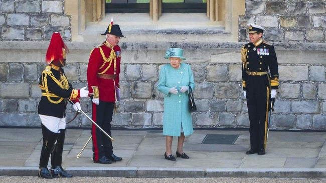 Britain's Queen Elizabeth II attends a ceremony to mark her official birthday at Windsor Castle in Windsor, England, Saturday June 13, 2020. Queen Elizabeth II's birthday is being marked with a smaller ceremony than usual this year, as the annual Trooping the Color parade is canceled amid the coronavirus pandemic. (Joanne Davidson/Pool via AP)