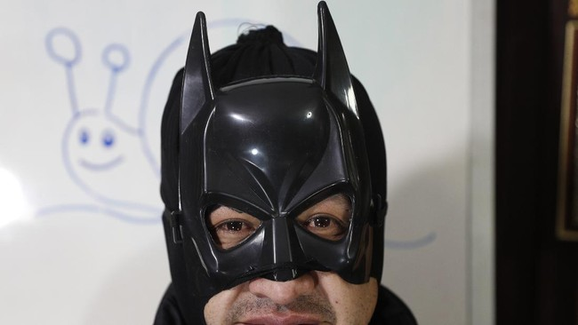 Art teacher Jorge Manolo Villarroel, wearing a Batman costume, poses for a photo at his home during one of his online classes, amid the new coronavirus pandemic, in La Paz, Bolivia, Tuesday, June 9, 2020. The class begins with a Zumba-style warm-up (Villarroel is also a Zumba instructor), followed by a prayer and then superhero music, to set the proper atmosphere. (AP Photo/Juan Karita)