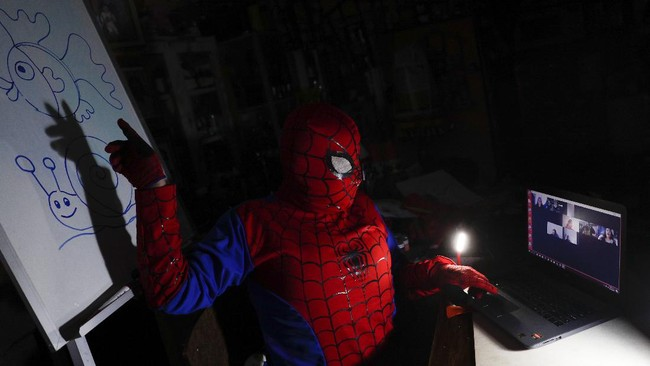 Art teacher Jorge Manolo Villarroel, wearing a Spider-Man costume, teaches an online class from his home, amid the new coronavirus pandemic in La Paz, Bolivia, Tuesday, June 9, 2020. Villarroel, who lives in a poor neighborhood of the capital, teaches art at the San Ignacio Catholic School in a wealthier area of the city. (AP Photo/Juan Karita)