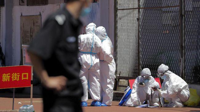 China melaporkan temuan sepuluh kasus baru virus corona di kelompok pekerja di pabrik pengolahan ayam.