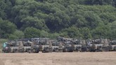 South Korean army's K-55 self-propelled howitzers are seen at the border with North Korea, South Korea, Tuesday, June 16, 2020. North Korea blew up an inter-Korean liaison office building just inside its border in an act Tuesday that sharply raises tensions on the Korean Peninsula amid deadlocked nuclear diplomacy with the United States. (AP Photo/Ahn Young-joon)
