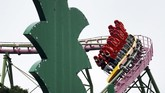 Visitors ride the roller coaster at the newly-opened Yomiuriland amusement park in Tokyo, Tuesday, June 16, 2020. The park has been closed since the end of March as a part of the precautions to help curb the spread of the  coronavirus. (AP Photo/Eugene Hoshiko)