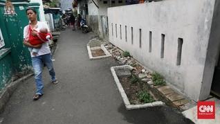 FOTO: Kuburan di Tengah Jalan Pisangan