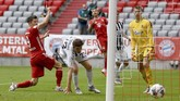 Munich's Robert Lewandowski, left, scores the goal for the 3-1  during the German Bundesliga soccer match between Bayern Munich and SC Freiburg in Munich, Germany, Saturday, June, 20, 2020. (Sven Hoppe/dpa via AP)