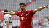 Munich's Robert Lewandowski cheers after his goal to 2-0 during the German Bundesliga soccer match between Bayern Munich and SC Freiburg in Munich, Germany, Saturday, June, 20, 2020. (Sven Hoppe/dpa via AP)
