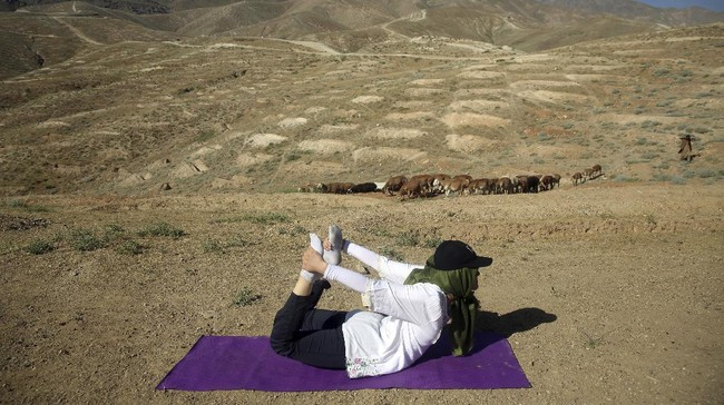 An Afghan enthusiast performs yoga to mark International Yoga Day amid the COVID-19 pandemic lockdown, on the outskirts of Kabul, Afghanistan, Sunday, June 21, 2020. (AP Photo/Rahmat Gul)