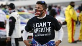 Driver Bubba Wallace wears a Black Lives Matter shirt as he prepares for a NASCAR Cup Series auto race Wednesday, June 10, 2020, in Martinsville, Va. (AP Photo/Steve Helber)