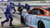 Bubba Wallace (43) makes a pit stop during a NASCAR Cup Series auto race Sunday, June 14, 2020, in Homestead, Fla. (AP Photo/Wilfredo Lee)
