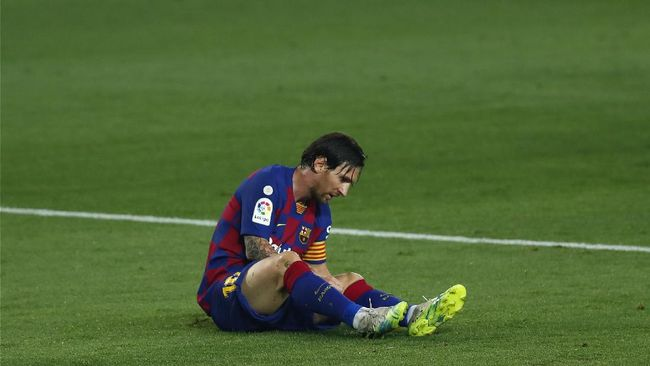 Barcelona's Lionel Messi lies on the pitch during the Spanish La Liga soccer match between FC Barcelona and Athletic Bilbao at the Camp Nou stadium in Barcelona, Spain, Tuesday, June 23, 2020. (AP Photo/Joan Monfort)