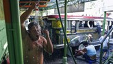 Jeepney driver Jude Recio takes a shower at the Tandang Sora terminal which have been home for them since a lockdown started three months ago, on Wednesday, June 17, 2020 in Quezon city, Philippines. About 35 jeepney drivers were forced to stay due to travel restrictions and have made jeepneys their home as the government banned public transport during the community quarantine to prevent the spread of the new coronavirus. Many of the jobless drivers have resorted to begging in the streets, displaying cardboard signs scrawled with pleas for money and food on their multi-colored jeepneys. (AP Photo/Aaron Favila)