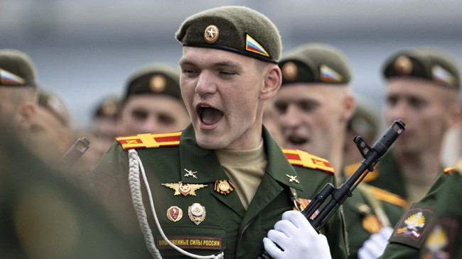 A Russian soldier sings a combat song as he marches toward Red Square to attend a dress rehearsal for the Victory Day military parade in Moscow, Russia. A massive military parade that was postponed by the coronavirus will roll through Red Square this week to celebrate the 75th anniversary of the end of World War II in Europe, even though Russia is continuing to register a steady rise in infections. (AP Photo/Alexander Zemlianichenko, File)