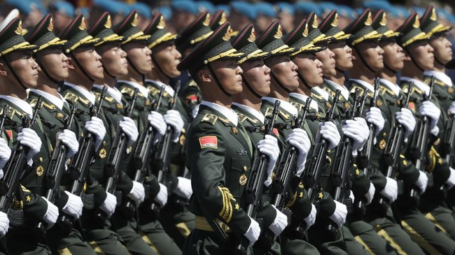 Soldiers from China's People's Liberation Army march toward Red Square during the Victory Day military parade marking the 75th anniversary of the Nazi defeat in Moscow, Russia, Wednesday, June 24, 2020. The Victory Day parade normally is held on May 9, the nation's most important secular holiday, but this year it was postponed due to the coronavirus pandemic. (AP Photo/Pavel Golovkin, Pool)