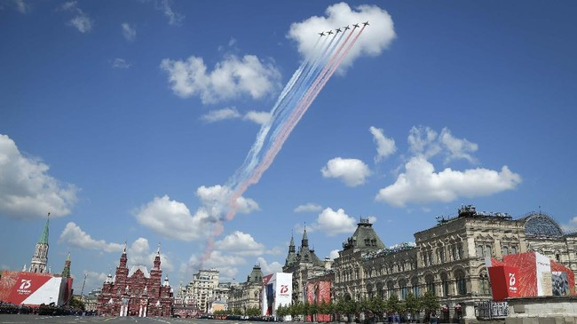Russian warplanes fly over Red Square leaving trails of smoke in colors of national flag during the Victory Day military parade marking the 75th anniversary of the Nazi defeat in Moscow, Russia, Wednesday, June 24, 2020. The Victory Day parade normally is held on May 9, the nation's most important secular holiday, but this year it was postponed due to the coronavirus pandemic. (AP Photo/Alexander Zemlianichenko)