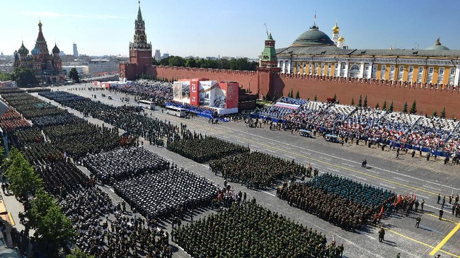 Parade formations are seen ahead of the military parade marking the 75th anniversary of the Nazi defeat on Red Square in Moscow, Russia, Wednesday, June 24, 2020.  The Victory Day parade normally is held on May 9, the nation's most important secular holiday, but this year it was postponed due to the coronavirus pandemic. (Mikhail Voskresenskiy, Host Photo Agency via AP)