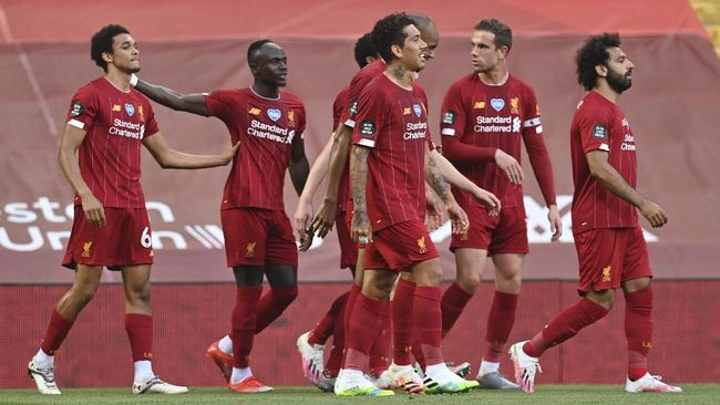 Liverpool's Trent Alexander-Arnold, left, celebrates after scoring the opening goal during the English Premier League soccer match between Liverpool and Crystal Palace at Anfield Stadium in Liverpool, England, Wednesday, June 24, 2020. (Paul Ellis/Pool via AP)
