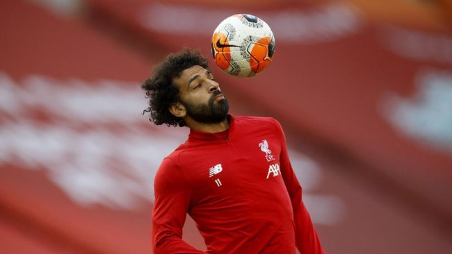 Liverpool's Mohamed Salah controls the ball as he warms-up before the English Premier League soccer match between Liverpool and Crystal Palace at Anfield Stadium in Liverpool, England, Wednesday, June 24, 2020. (Phil Noble/Pool via AP)