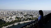 A visitor looks at the view from the Eiffel Tower, in Paris, Thursday, June 25, 2020. The Eiffel Tower reopens after the coronavirus pandemic led to the iconic Paris landmark's longest closure since World War II. (AP Photo/Thibault Camus)