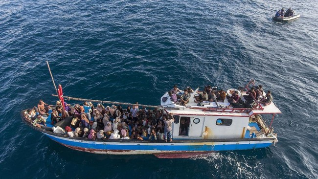 This drone shot shows a boat carrying ethnic-Rohingya off North Aceh, Indonesia, Wednesday, June 24, 2020. Indonesian fishermen discovered dozens of hungry, weak Rohingya Muslims on the wooden boat adrift off Indonesia's northernmost province of Aceh, an official said. (AP Photo/Zik Maulana)