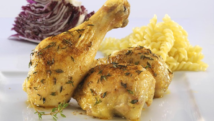 Chicken legs with pasta and lettuce