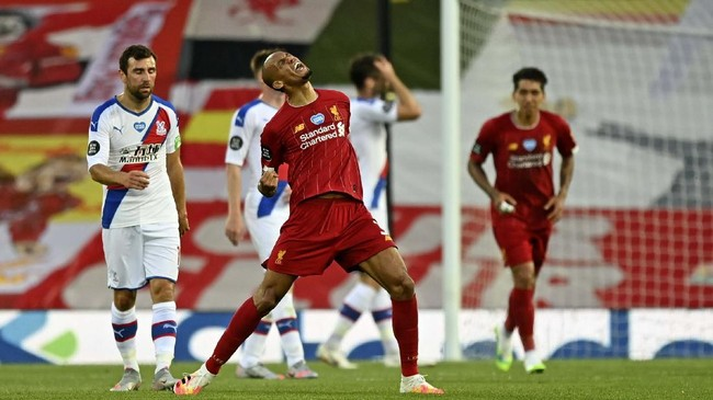 Liverpool's Fabinho scores his side's third goal during the English Premier League soccer match between Liverpool and Crystal Palace at Anfield Stadium in Liverpool, England, Wednesday, June 24, 2020. (Shaun Botterill/Pool via AP)