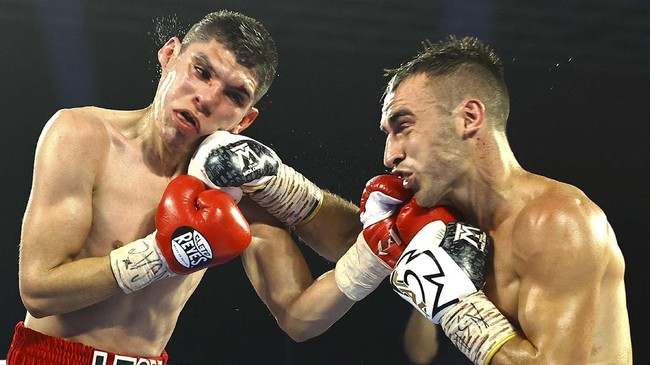 LAS VEGAS, NEVADA - JUNE 25: In this handout photo provided by Top Rank, Jason Moloney fights Leonardo Baez during their bantamweight bout at MGM Grand Conference Center Grand Ballroom on June 25, 2020 in Las Vegas, Nevada.   Mikey Williams/Top Rank via Getty Images/AFP