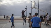 Youths play basketball in a reopened court after lockdown measures were lifted in Rabat, Morocco, Thursday, June 25, 2020. (AP Photo/Mosa'ab Elshamy)