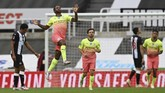 Manchester City's Raheem Sterling celebrates after scoring his side's second goal during the FA Cup sixth round soccer match between Newcastle United and Manchester City at St. James' Park in Newcastle, England, Sunday, June 28, 2020. (Shaun Botterill/Pool via AP)