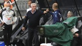 Manchester City's head coach Pep Guardiola, right, greets Newcastle's head coach Steve Bruce before the FA Cup sixth round soccer match between Newcastle United and Manchester City at St. James' Park in Newcastle, England, Sunday, June 28, 2020. (Shaun Botterill/Pool via AP)
