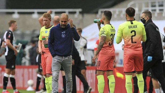 Manchester City's head coach Pep Guardiola reacts during a drinks break during the FA Cup sixth round soccer match between Newcastle United and Manchester City at St. James' Park in Newcastle, England, Sunday, June 28, 2020. (Owen Humphreys/Pool via AP)
